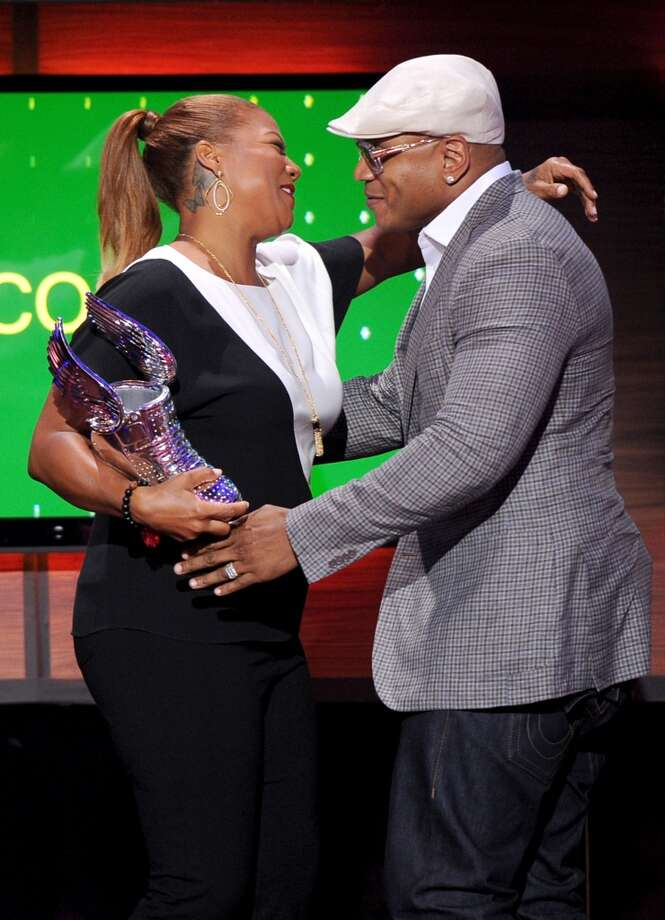 LL Cool J accepts award from presenter Queen Latifah onstage at the DoSomething.org and VH1's 2013 Do Something Awards at Avalon on July 31, 2013 in Hollywood, California.  (Photo by Kevin Winter/Getty Images) Photo: Kevin Winter, Getty Images