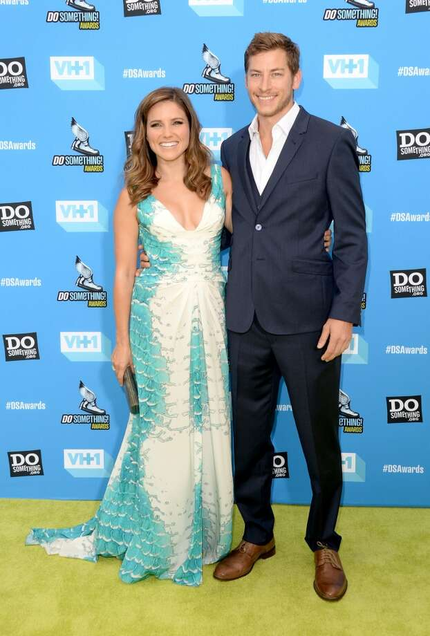 Host Sophia Bush (L) and Google executive Dan Fredinburg arrive at the DoSomething.org and VH1's 2013 Do Something Awards at Avalon on July 31, 2013 in Hollywood, California.  (Photo by Jason Merritt/Getty Images) Photo: Jason Merritt, Getty Images
