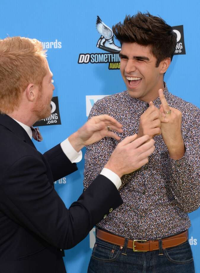 Actor Jesse Tyler Ferguson (L) and Justin Mikita, showing off his wedding ring, arrive at the DoSomething.org and VH1's 2013 Do Something Awards at Avalon on July 31, 2013 in Hollywood, California.  (Photo by Jason Merritt/Getty Images) Photo: Jason Merritt, Getty Images