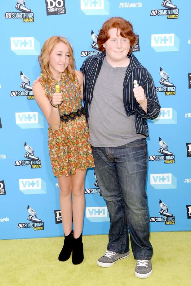 Actors Noah Cyrus (L) and Tucker Albrizzi arrive at the DoSomething.org and VH1's 2013 Do Something Awards at Avalon on July 31, 2013 in Hollywood, California.  (Photo by Jason Merritt/Getty Images) Photo: Jason Merritt, Getty Images