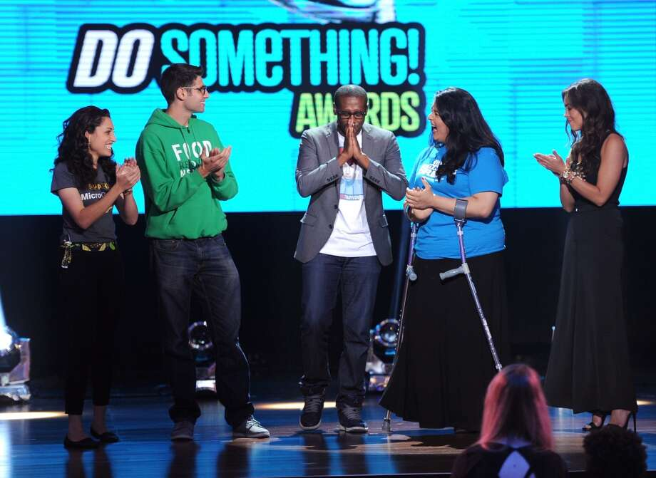 (L-R) Sasha Fisher of Spark MicroGrants, Ben Simon of Food Recovery Network, Daniel Maree of Millions of Hoodies Movement for Justice, Lorella Pareli of United We Dream, and Jillian Mourning of All We Want Is L.O.V.E. stand onstage at the DoSomething.org and VH1's 2013 Do Something Awards at Avalon on July 31, 2013 in Hollywood, California.  (Photo by Kevin Winter/Getty Images) Photo: Kevin Winter, Getty Images