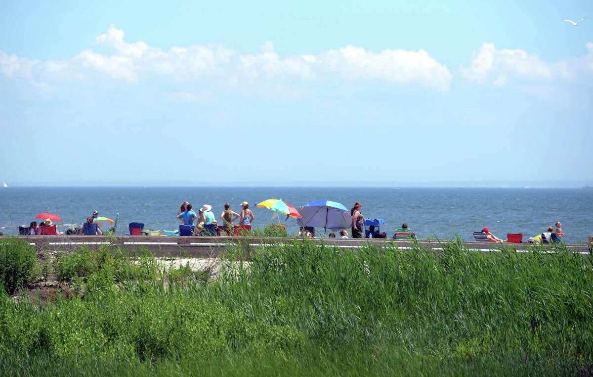 People flocked to the shore on a hot holiday Wednesday, July 4, 2013 at Silver Sands State Park in Milford, Conn.