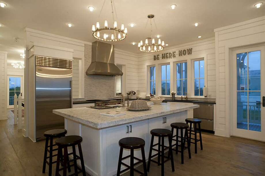 Honed Carrera Marble Island & Honed slate perimeter counters; custom self closing drawers & cabinets w/custom inserts for dishes; under counter lighting; see inventory for complete list of brand named appliances.See the listing here