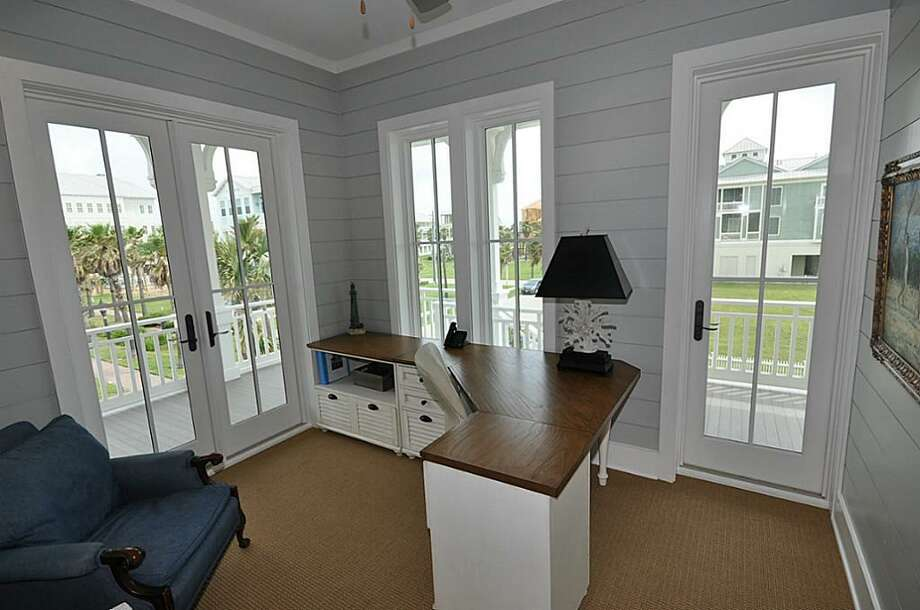 Second floor study with built in bookcases, desk with file cabinets, Nuvo wall keypad with Klipsch ceiling speakers, double French foors and one single French door lead to wrap-around porch with views of Gulf, walkover and Village.See the listing here