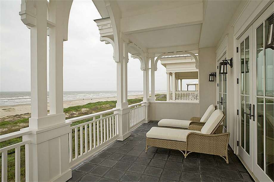 Large Private porch with slate floor, corbels and columns, and 3 sets of double-French doors. Can't you just imagine losing yourself to the sea in one of the most comfortable lounge chairs you will ever enjoy?