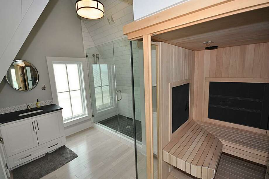 Sunlighten mPulse eMPOWER 6-person infrared sauna with sound system; En-suite bathroom with slate floors and counter tops; shower with double shower heads; private water closet; loft above sauna with futon sofa; custom light fixtures.See the listing here