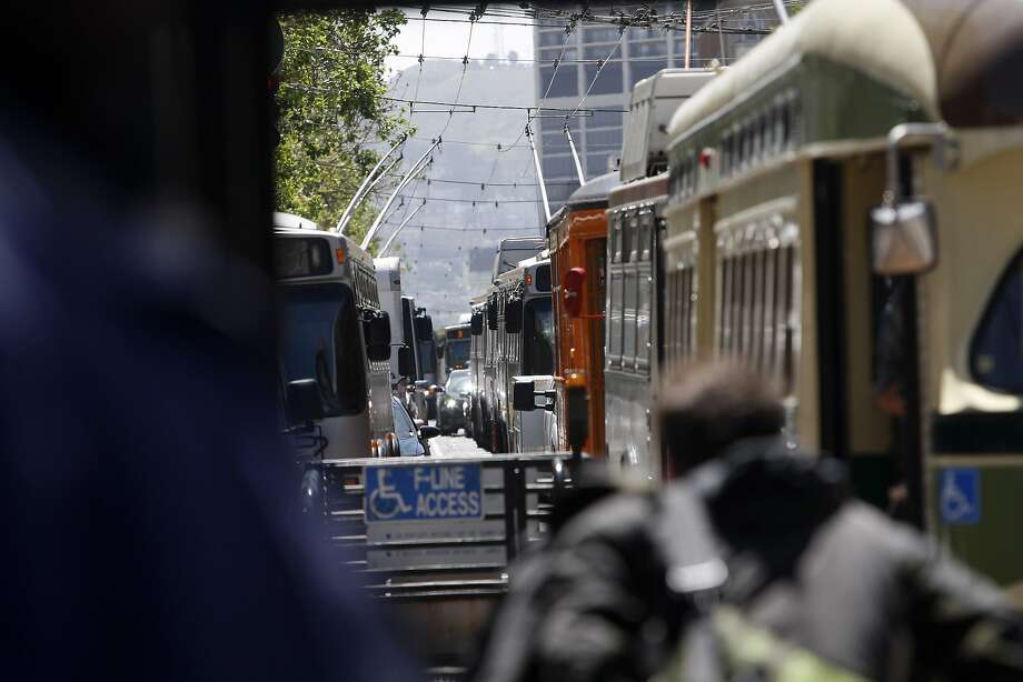 Bikes and buses hold sway over cars in S.F. under the transit first policy. Photo: Sean Culligan, The Chronicle