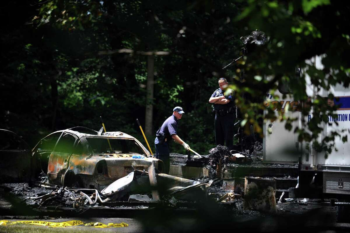 The woman who died in a house fire on Davis Road in Seymour Wednesday July 31, 2013 was so badly burned that DNA testing is needed to make a positive identification, a fire official said. The fire started in the two-car garage, where firefighters found the burned body.