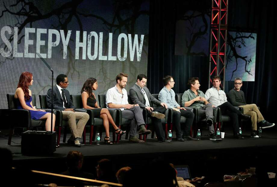 """BEVERLY HILLS, CA - AUGUST 01:  (L-R) Actress Katia Winter, Orlando Jones, Nicole Beharie, Tom Mison, Co-Creator/Supervising Producer Phillip Iscove, Executive Producer Mark Goffman, Co-Creator/Executive Producer Len Wiseman,  Co-Creator/Executive Producer Roberto Orci,  and Co-Creator/Executive Producer Alex Kurtzman speak onstage during the """"Sleepy Hollow"""" panel discussion at the FOX portion of the 2013 Summer Television Critics Association tour - Day 9 at The Beverly Hilton Hotel  on August 1, 2013 in Beverly Hills, California. Photo: Frederick M. Brown, Getty Images / 2013 Getty Images"""