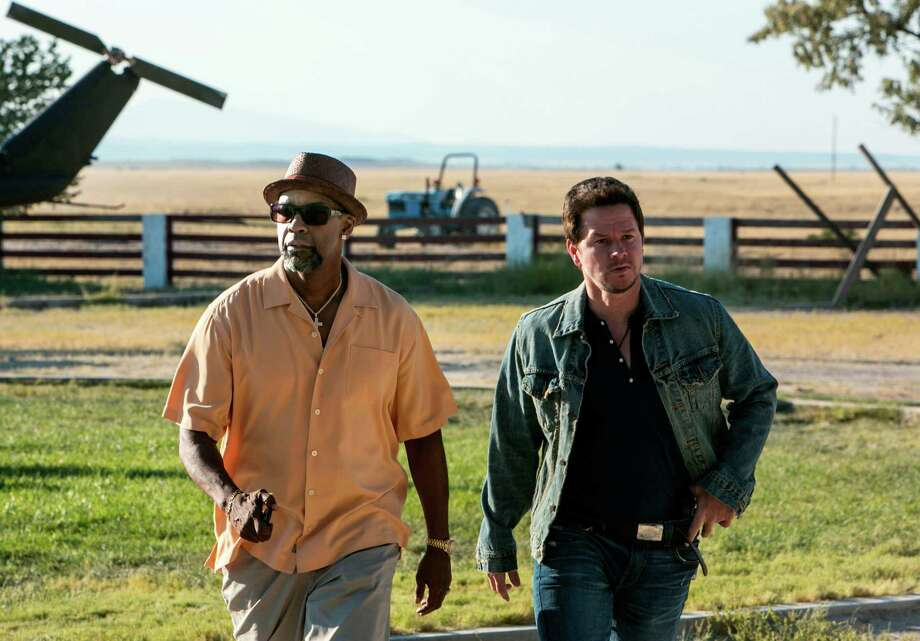 "This image released by Universal Pictures shows Denzel Washington, left, and Mark Wahlberg in a scene from ""2 Guns."" (AP Photo/Universal Pictures, Patti Perret) ORG XMIT: NYET732 Photo: Patti Perret / Universal Pictures"