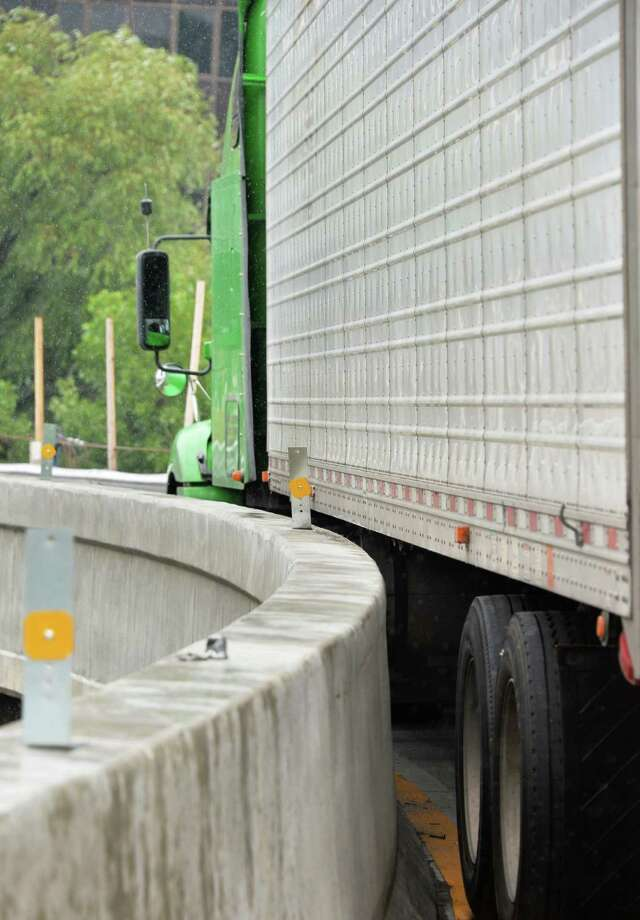 A tractor trailer was wedged stuck on the northbound ramp from Crossgates Mall to the Northway Thursday August 1, 2013, in Guilderland, N.Y. The vehicle failed to heed a no truck traffic sign.  (John Carl D'Annibale / Times Union) Photo: John Carl D'Annibale / 10023375A