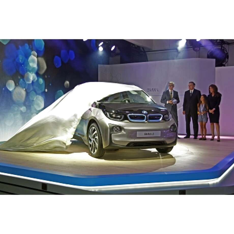 BMW introduced its new i3 SUV. The company's first electric car will make its debut  next spring.