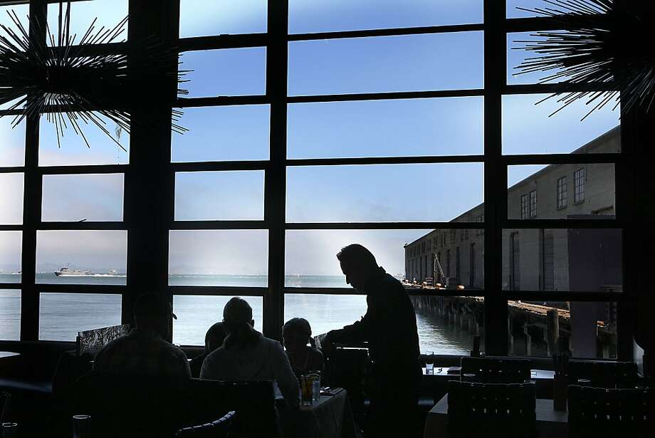 Butterfly's floor-to-ceiling windows offer a wide vista of the bay and working pier. The menu at the expansive restaurant and bar includes Vietnamese-inspired fare from chef Robert Lam. Photo: Liz Hafalia, The Chronicle