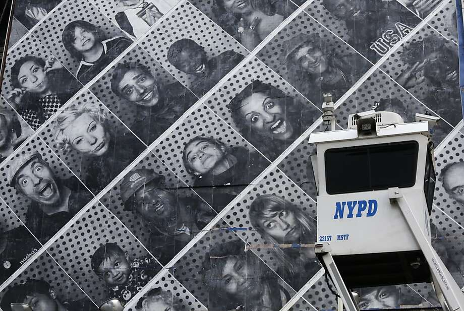You're on candid camera, New York: An NYPD SkyWatch observation tower stands in front of 