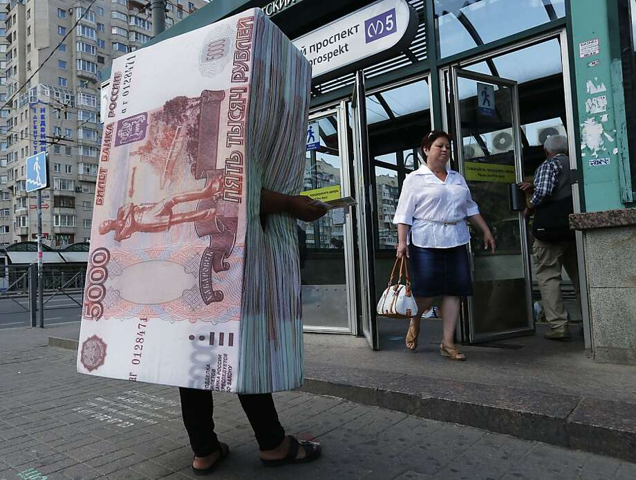 Make your money work for you:A 5,000-ruble bankroll (about $160) with legs distributes   ads for a credit company in St. Petersburg, Russia. Photo: Dmitry Lovetsky, Associated Press