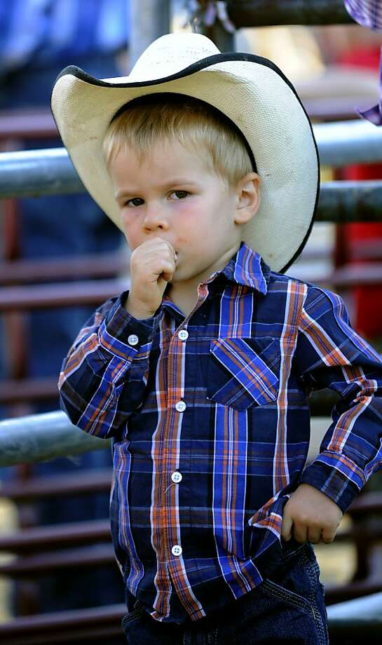 "Don't make me draw, podner: Three-year-old Matthew Crum - the ""Tastiest Thumb in the West"" - holsters his weapon outside the rodeo ring during Wild West Night at the Carroll County (Md.) 4-H & FFA Fair. Photo: Dylan Slagle, Associated Press"