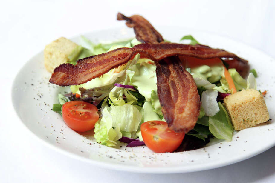 Del Frisco's Dinner Salad is one of three dishes on the menu for Houston Restaurant Weeks.  The restaurant is located at 5061 Westheimer. For a complete list of Houston Restaurant Week restaurants, as well as menus and maps, go to houstonrestaurantweeks.com. Photo: Mayra Beltran, Houston Chronicle / © 2013 Houston Chronicle