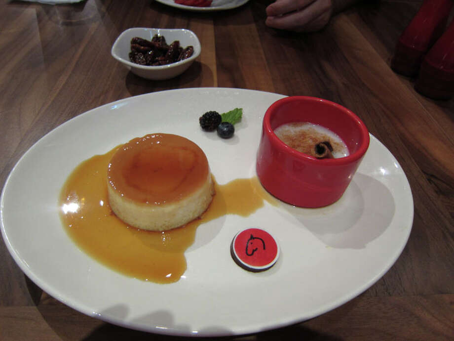 Flan and rice pudding as served at La Casa del Caballo during Houston Restaurant Weeks. The restaurant is located at 322 Westheimer. For a complete list of Houston Restaurant Week restaurants, as well as menus and maps, go to houstonrestaurantweeks.com. Photo: Syd Kearney, Houston Chronicle