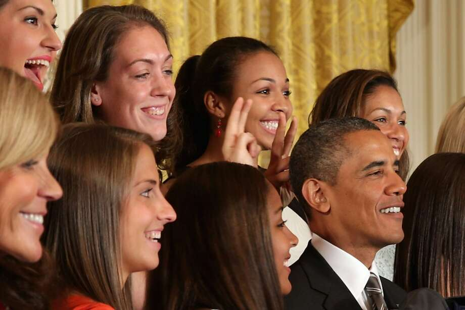 "Surprised Romo didn't try this: Stefanie Dolson (left) and Kiah Stokes (center) give President Obama ""bunny ears"" as the national champion University of Connecticut Huskies pose for a picture with the Leader of the Free World in the East Room of the White House. Photo: Chip Somodevilla, Getty Images"