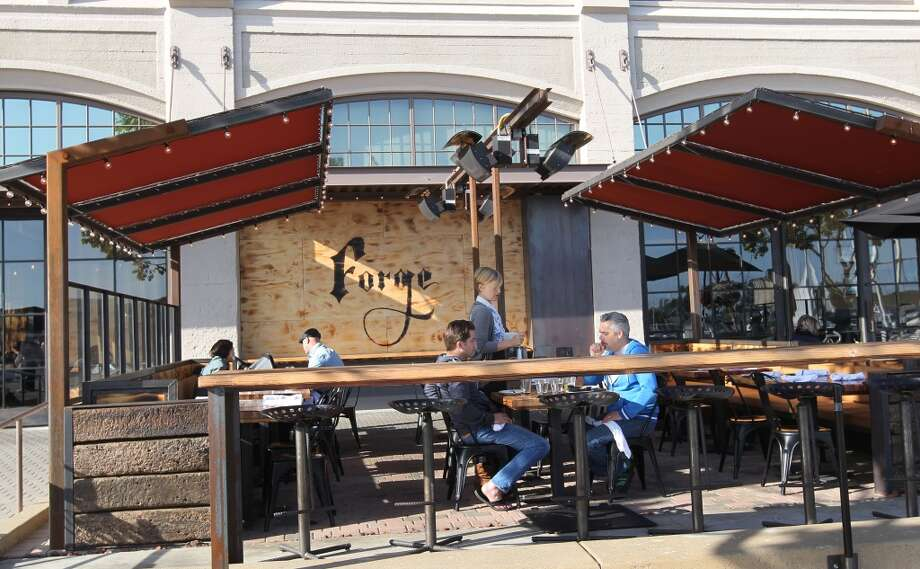 The Forge restaurant and bar offers a wide verity of Food creative dishes and drinks including out door seating in a warm inviting space at OaklandÕs Jack London Square Saturday, May 25, 2013 in Oakland Calif. Photo: The Chronicle