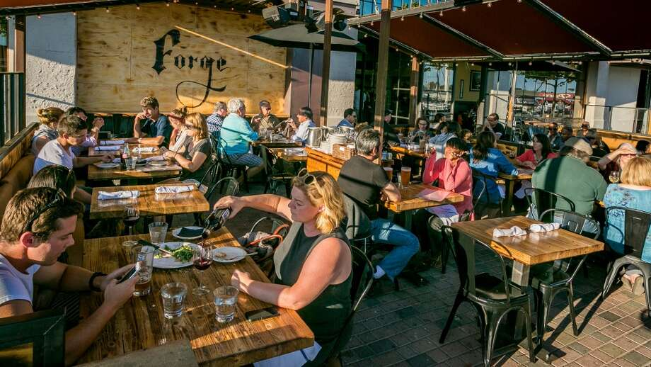 Diners enjoy dinner on the patio at Forge 66 in Oakland, Calif., on Wednesday, July 25th, 2013. Photo: Special To The Chronicle
