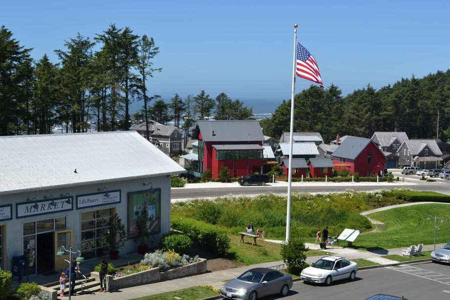 Seabrook, with the town market in the foreground, and one of Sunset's Idea Houses in the background (tallest red house behind the flagpole). Photo: Seabrook
