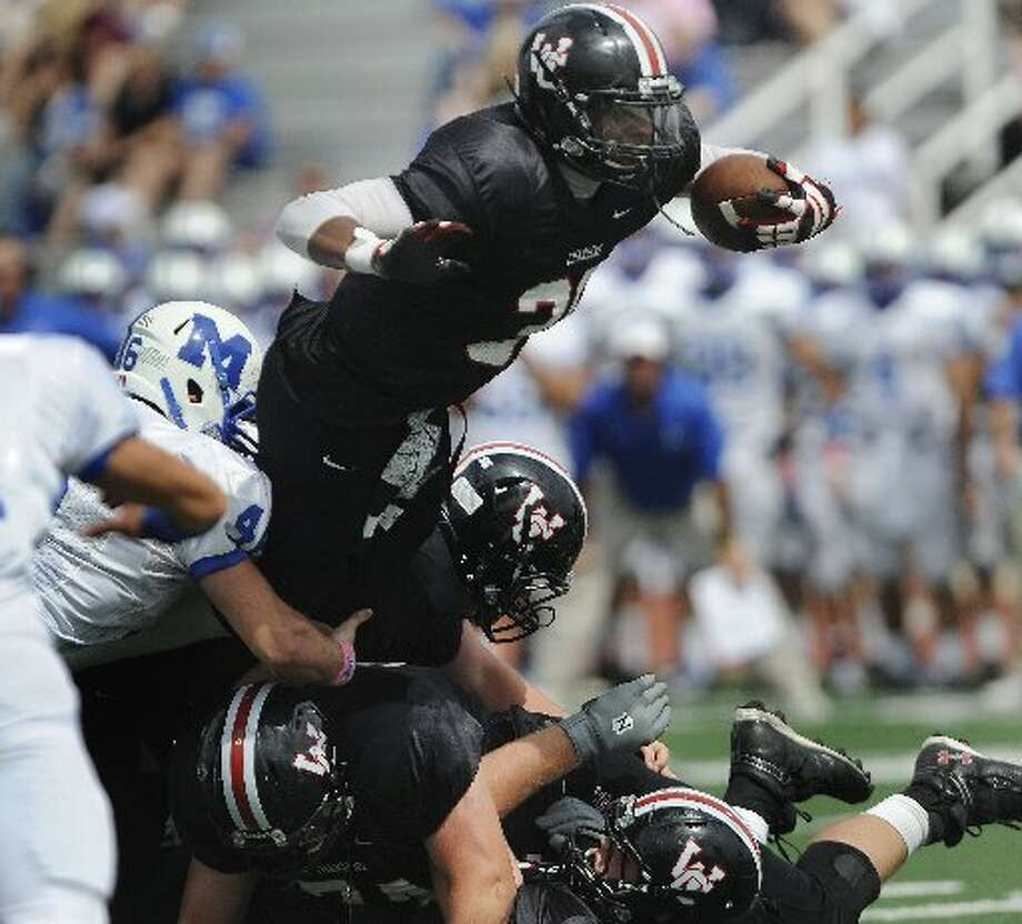 26-5A: Churchill wide receiver Dimitri Flowers may be the area's most versatile player. Photo: E-N