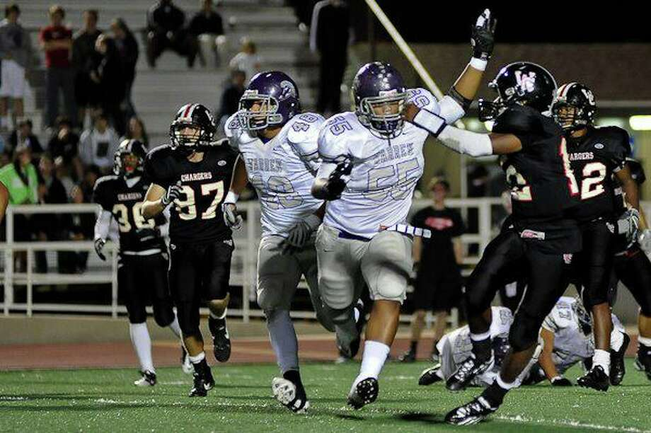 27-5A: Warren defensive tackle Trey Lealaimatafao (55) is a monster in the trenches.