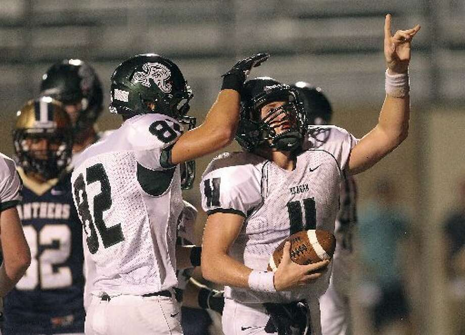 26-5A: Reagan quarterback Ty Summers was primarily a running quarterback last season. Photo: E-N