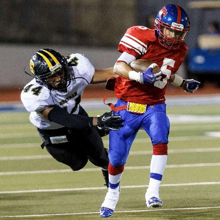 28-4A: Brennan linebacker Grant Watanabe. Photo: E-N