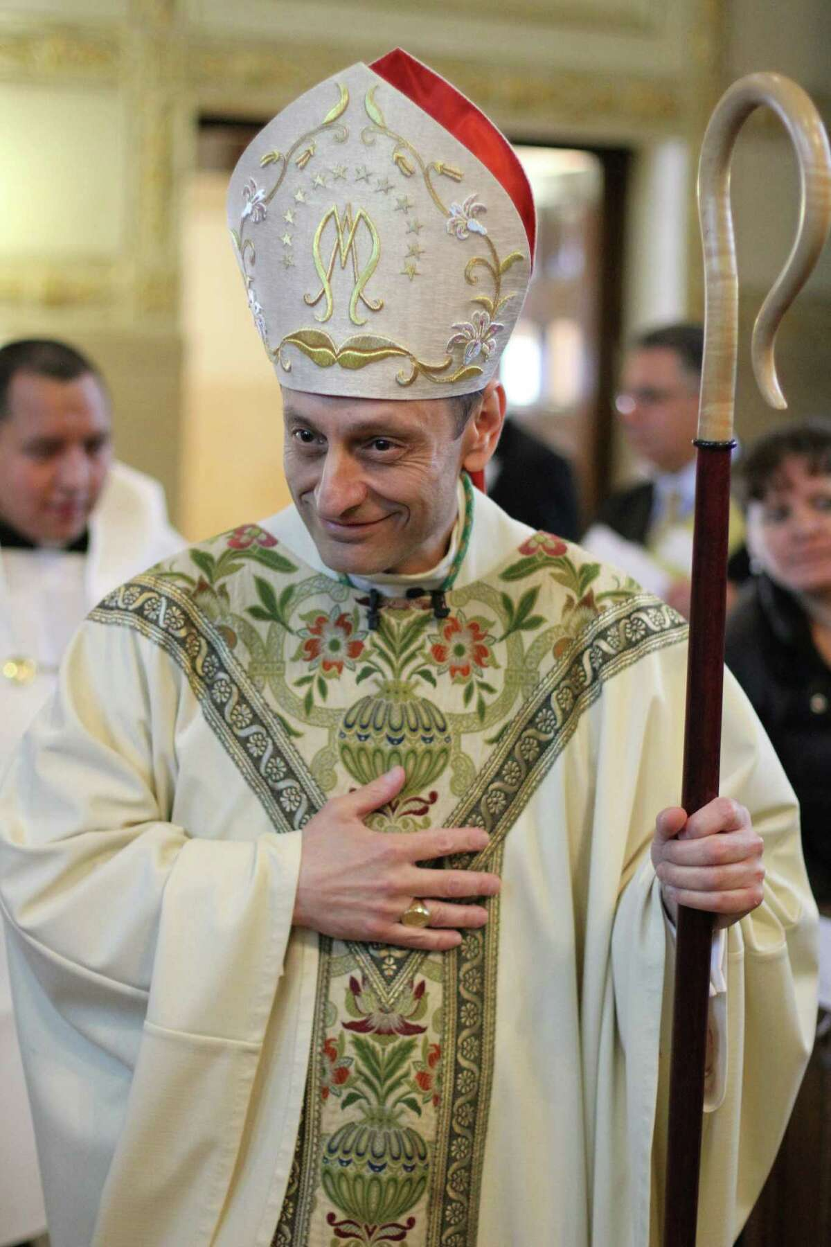Auxiliary Bishop Frank J. Caggiano of Brooklyn, N.Y., smiles as he arrives to preside at the ordination of permanent deacons at Our Lady of Angels Church in the Bay Ridge neighborhood of the New York borough of Brooklyn May 25, 2013.