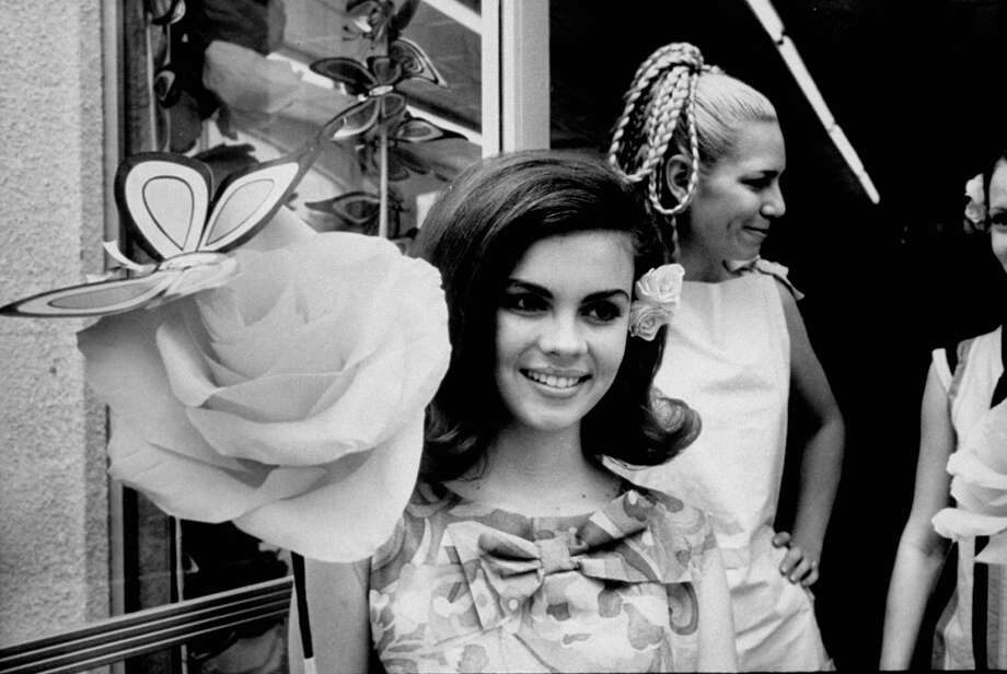 Student Shari McGar sells paper flowers at HemisFair in 1968. Photo: Yale Joel, Time & Life Pictures / Getty Images / Time Life Pictures