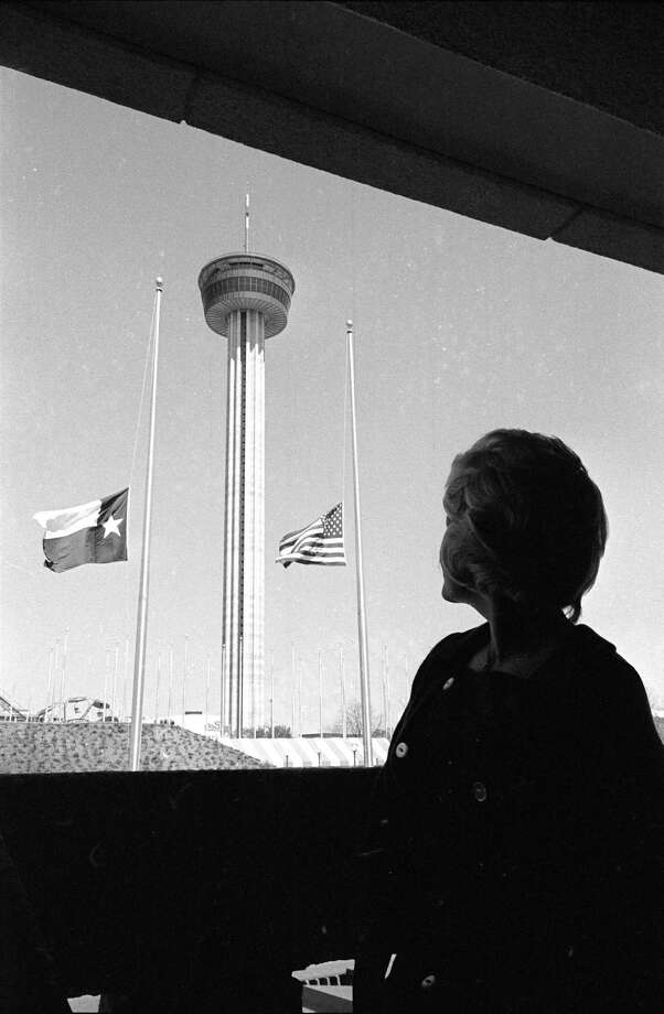 The United States and Texas flags fly at half mast at the Institute of Texan Cultures at the HemisFair '68, in memory of Dr. Martin Luther King, Jr., April 5, 1968, in San Antonio.  The Tower of the Americas is in the background. Photo: FERD KAUFMAN, Associated Press / AP1968