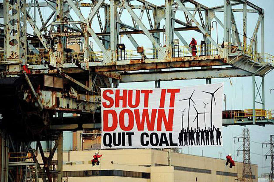 """Greenpeace activists deploy 40-by-20-foot banner reading """"Shut it Down - Quit Coal"""" at the Bridgeport Harbor Generating Station coal elevator in February 2011. Photo: Greenpeace / Westport News"""
