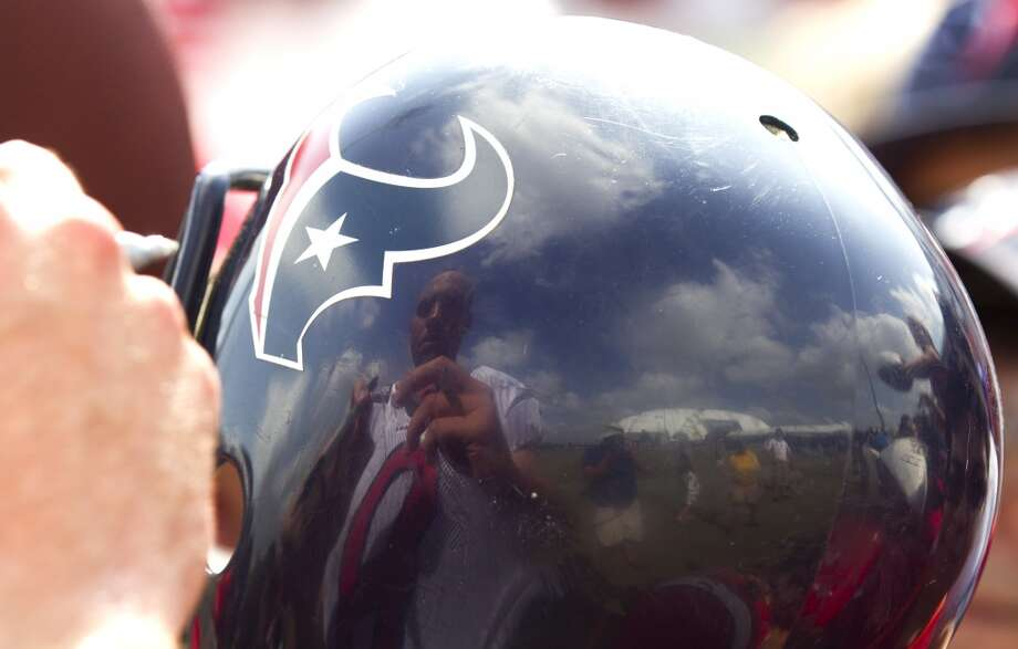 Texans quarterback Matt Schaub autographs a toy helmet. Photo: Brett Coomer, Houston Chronicle