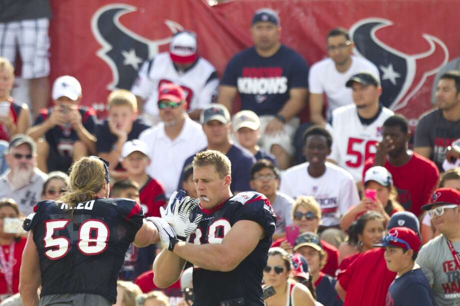 Texans outside linebacker Brooks Reed and defensive end J.J. Watt work on hand drills. Photo: Brett Coomer, Houston Chronicle