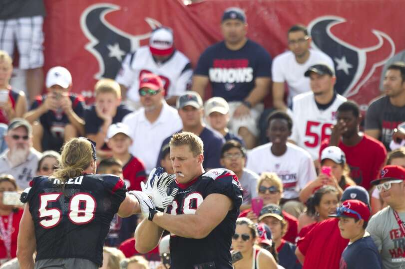 Texans outside linebacker Brooks Reed and defensive end J.J. Watt work on hand drills.