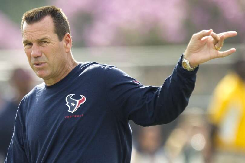 Texans head coach Gary Kubiak calls out for the next drill.