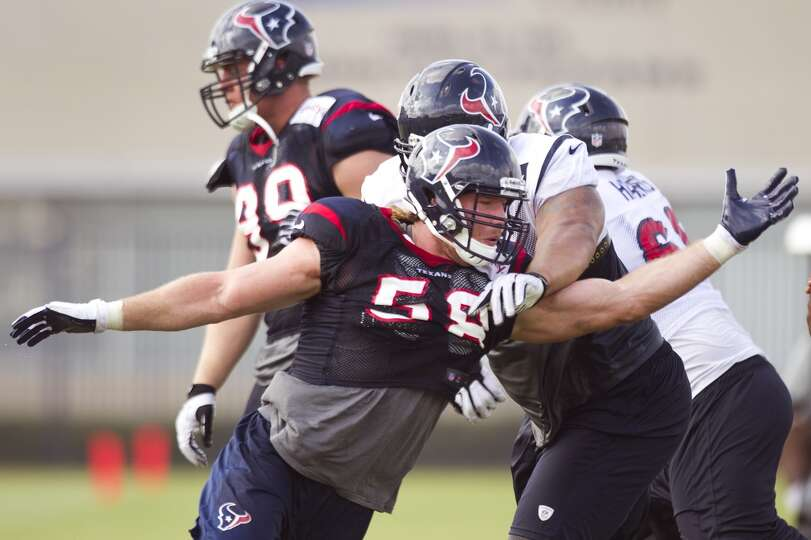 Texans outside linebacker Brooks Reed runs through a pass rush drill.