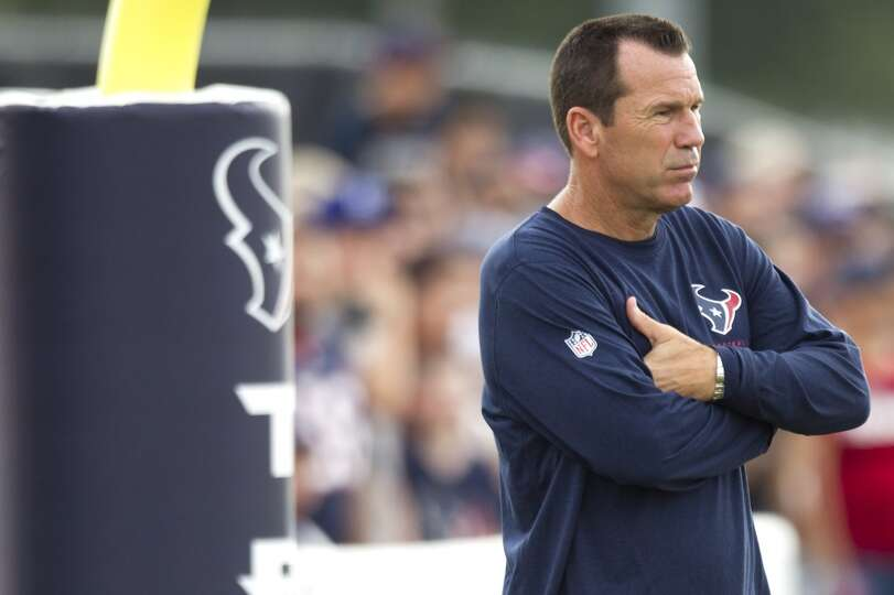 Texans head coach Gary Kubiak watches practice.