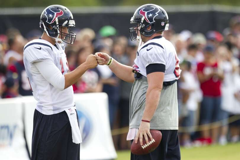 Texans punter Andrew Shapiro and long snapper Jon Weeks fist bump before a special teams drill.