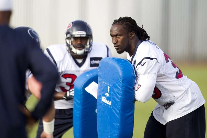 Texans fullback Greg Jones holds a blocking pad.