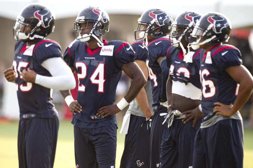 Texans defensive backs line up to run drills.