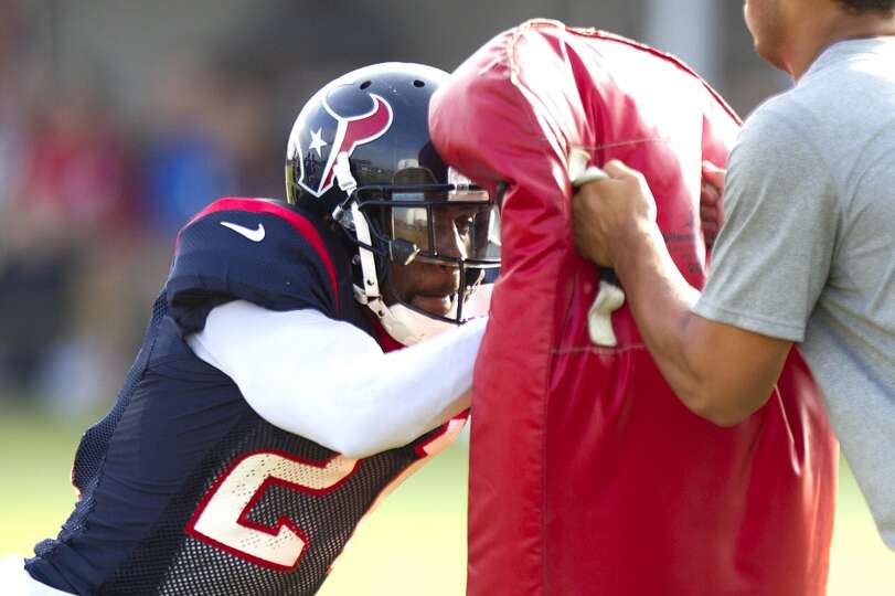 Texans cornerback Travis Howard hits a blocking pad.