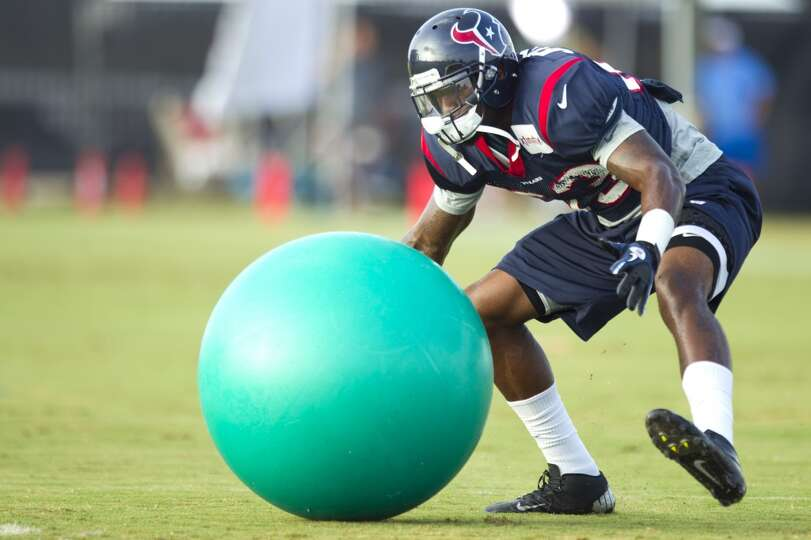 Texans linebacker Willie Jefferson runs to grab a ball during a drill.