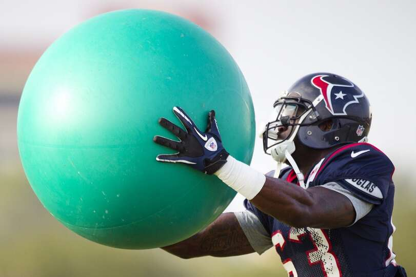 Texans linebacker Willie Jefferson grabs a ball during a drill.