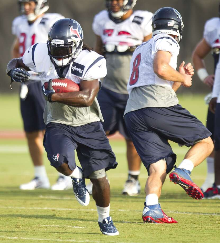 Texans running back Deji Karim takes a handoff from Matt Schaub. Photo: Brett Coomer, Houston Chronicle