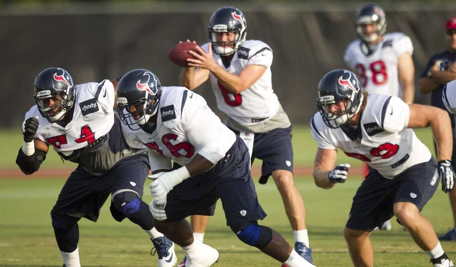 Texans guard Wade Smith , tackle Duane Brown and tight end Jake Byrne break off the line as quarterback Matt Schaub takes the snap. Photo: Brett Coomer, Houston Chronicle