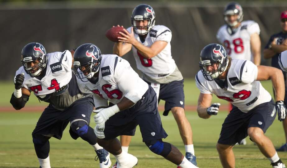 Texans guard Wade Smith , tackle Duane Brown and tight end Jake Byrne break off the line as quarterb