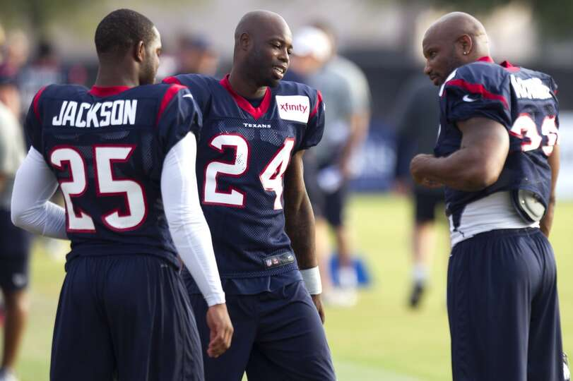Texans defensive backs Kareem Jackson,  Johnathan Joseph and free safety Danieal Manning talk before